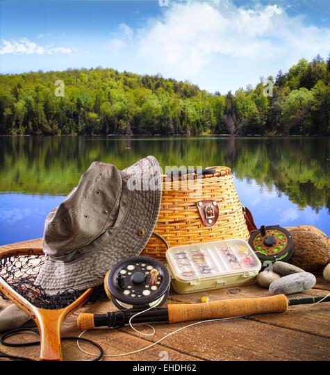 Bass fishing lake stock photos bass fishing lake stock for Fishing supplies near me