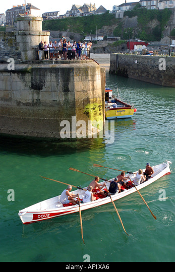 Pilot gig leaving the harbour at Newquay Cornwall UK - Stock Image