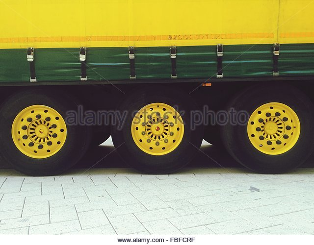 High Angle View Of Yellow Semi-Truck Tires - Stock Image
