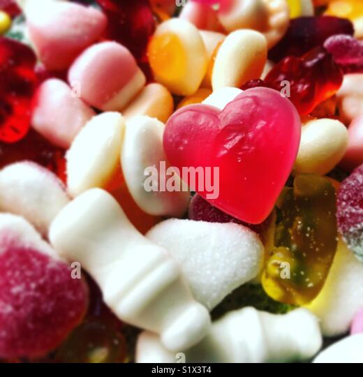 Close up view of a heart shaped sweet - Stock Image