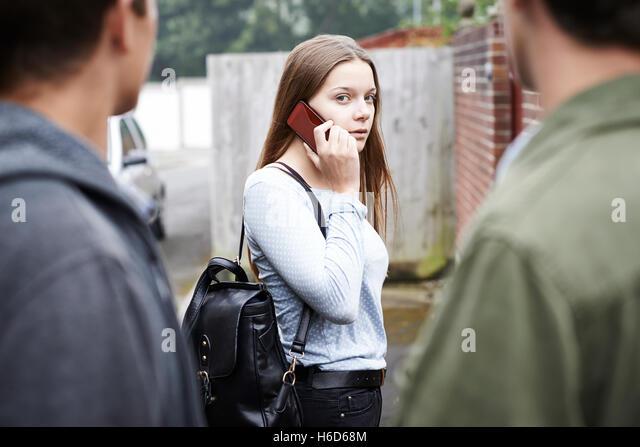 Teenage Girl Feeling Intimidated As She Walks Home - Stock Image