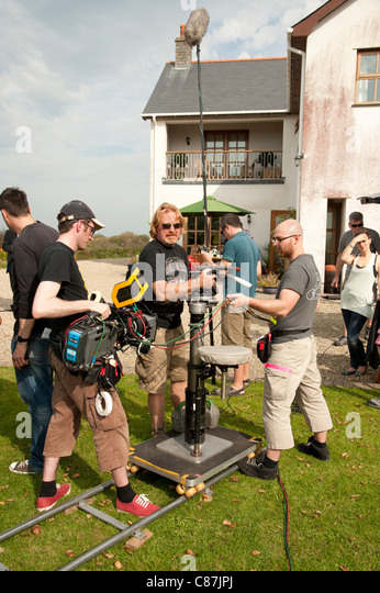 A camera crew working on the location recording of a television drama series, UK - Stock Image