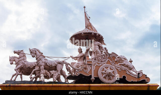 Sculpture of Hindu God Krishna and Arjuna at Rishikesh, Uttarakhand,  India - Stock Image