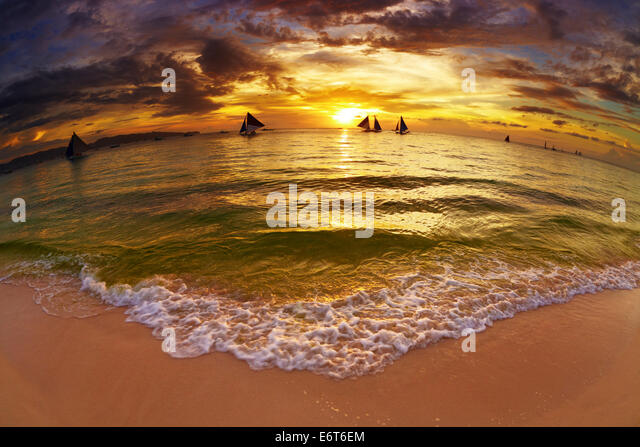 Tropical beach at sunset, Boracay island, Philippines, fisheye shot - Stock Image