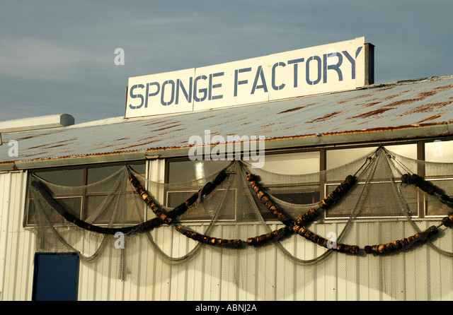 Tarpon Springs Florida Sponge Factory Sign Fishing Floats strung along wall - Stock Image