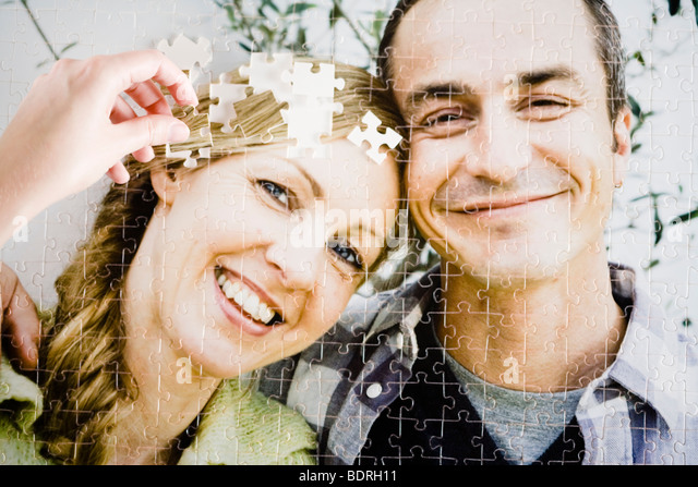 A puzzle with the image of a couple. - Stock Image