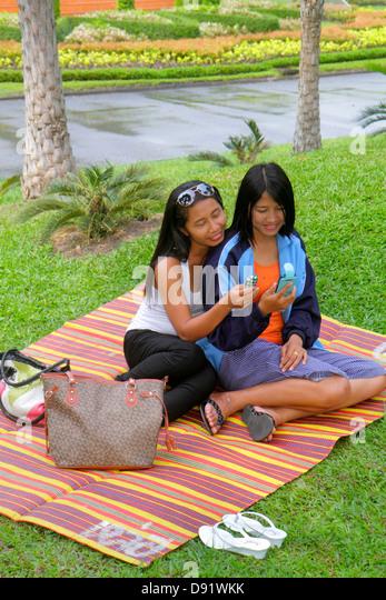 Thailand Bangkok Chatuchak Park Asian woman leisure relaxing mat - Stock Image