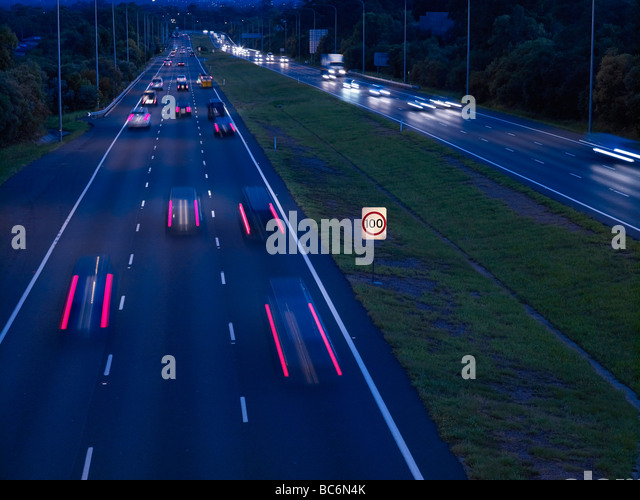 Night traffic M1 freeway Brisbane Australia - Stock Image