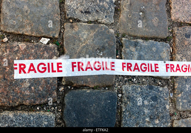Fragile line on pavement - Stock Image