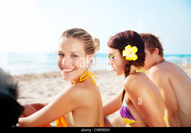 group of young people enjoying the beach - Stock Image