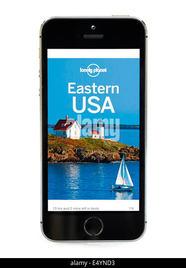 Travel Guide on the Eastern USA by Lonely Planet displayed on Apple iPhone 5S Kindle app. - Stock-Bilder