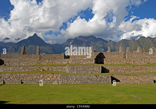 The terraced Inca ruins of Machu Picchu with the Andes Mountains behind in the Sacred Valley of Peru at sunset. - Stock Image