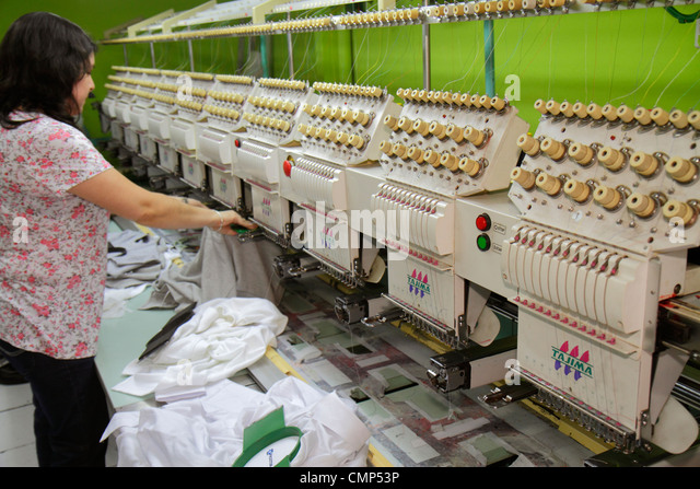 Santiago Chile Barrio Patronato Antonia Lopez de Bello Tajima embroidery machine garment factory textile industry - Stock Image