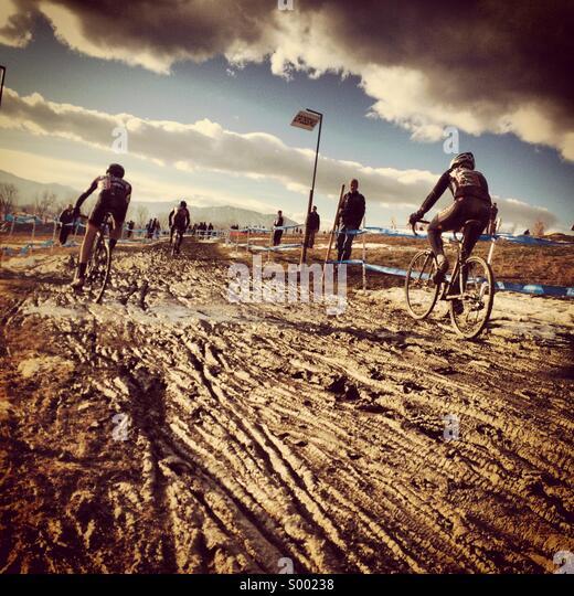 Muddy cyclocross race - Stock Image