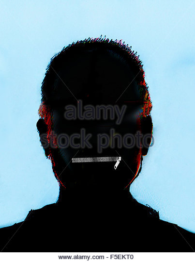 Silhouette of man's head with closed zipper mouth - Stock Image