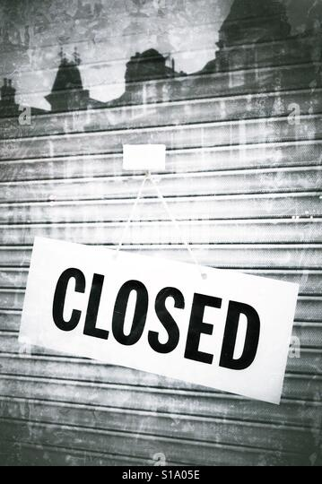 A closed shop sign - Stock Image