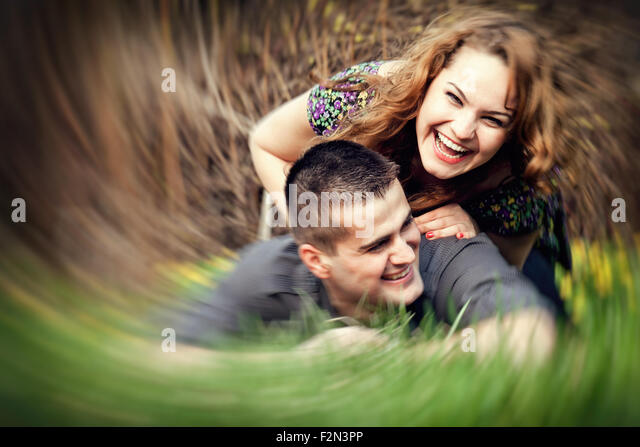 Happy young couple having fun outdoors - Stock Image