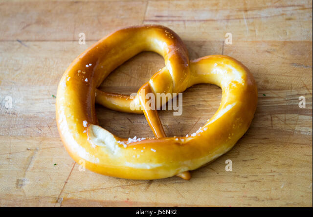 A soft pretzel (butter-and-salt flavour) from Zwick's Pretzels in Edmonton, Alberta, Canada. - Stock Image