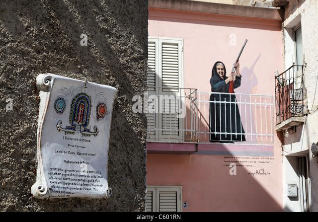 Murales, wall painting, Oliena village, Nuoro Province, Sardinia, Italy - Stock Image