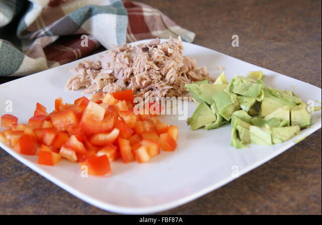 Tuna salad ingredients prepped on a plate. - Stock Image