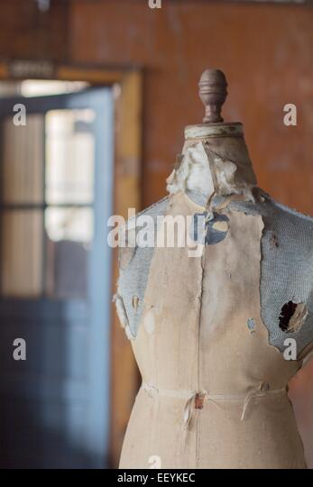 An old dress form in an abandoned clothing factory. - Stock-Bilder