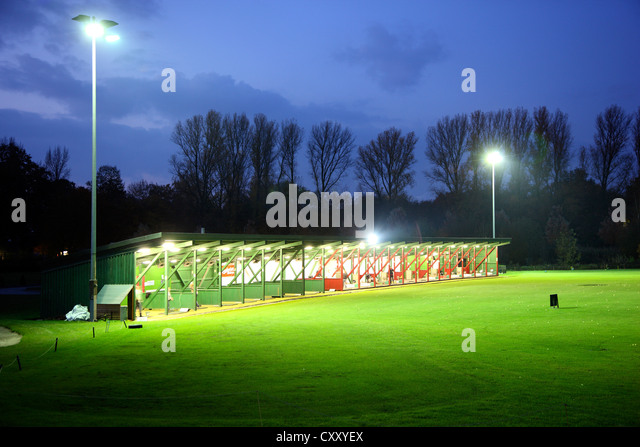 Driving range at night, illuminated, Schloss Horst golf course, Gelsenkirchen, Germany - Stock Image