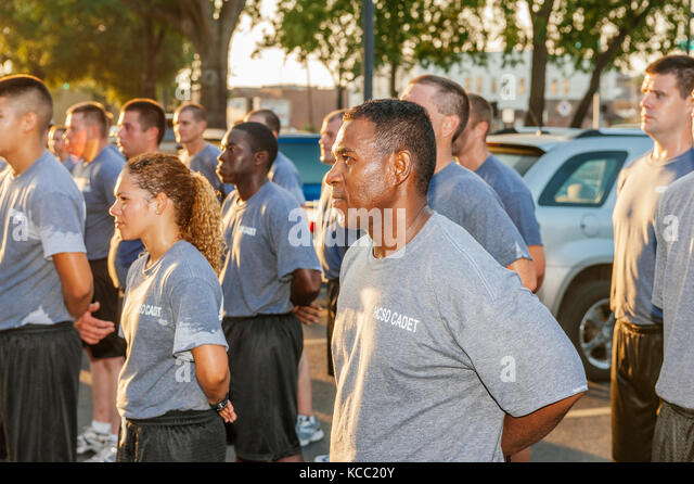 Police, law enforcement recruit class standing in formation after training run through streets of Ybor City, Tampa, - Stock Image