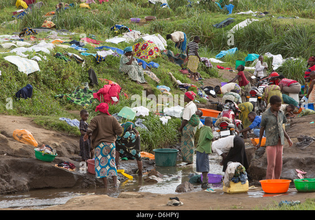 Residents of Kishusha ? Rubaya Camp in Masisi Territory, North Kivu Province in Eastern DRC, wash clothes in a nearby - Stock-Bilder