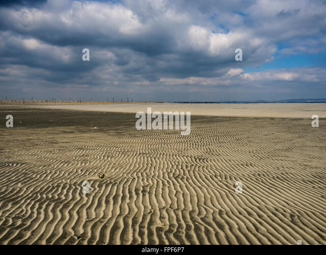 Ripples in the sand and a pebble at East Head, West Wittering, West Sussex - Stock Image