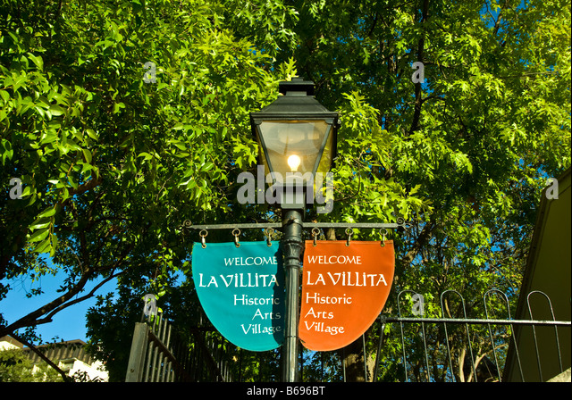 La Villita historic arts village red blue banners street lamp san Antonio texas tx tourist attraction shopping district - Stock Image