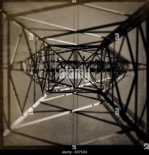 Looking straight up from the inside of a metal electrical tower. - Stock-Bilder