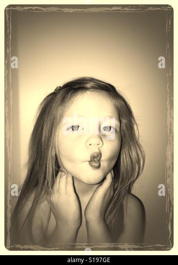 Little girl making fish lips - Stock-Bilder