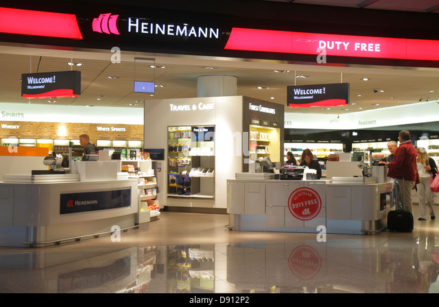 Germany Frankfurt am Main Airport FRA terminal gate area concourse shopping front entrance retail display for sale - Stock Image