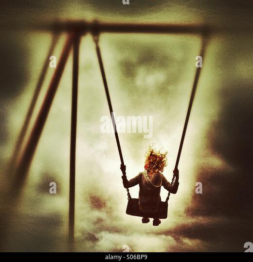 Girl on swing - Stock Image