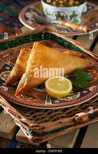 Brik à l'oeuf. Fried Tunisian pastries. Tunisia Food - Stock Image
