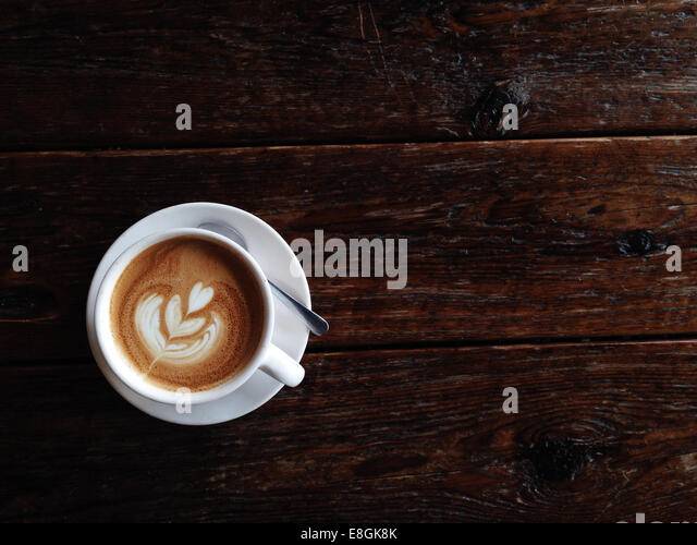 Overhead view of a latte coffee - Stock Image