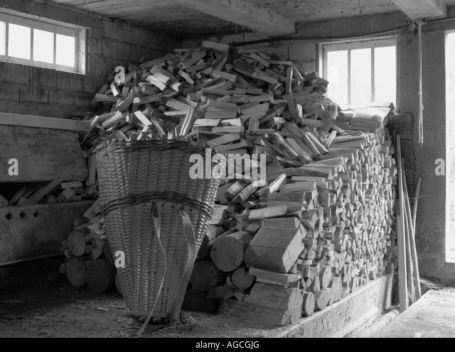 Basket of logs stock photos images