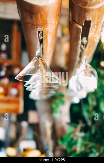 Hanging glasses in bar on the beach , shallow focus - Stock Image