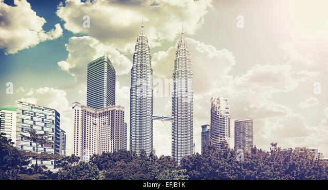Retro vintage filtered picture of Kuala Lumpur skyline. - Stock Image