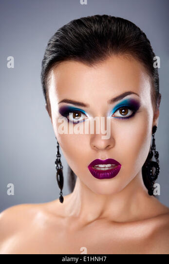 Holiday evening make-up. Styling beauty young female face - Stock Image