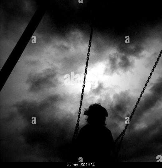 On a swing - Stock-Bilder