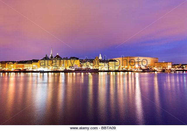 Skeppsbron waterfront at night, Gamla Stan, Stockholm. - Stock Image