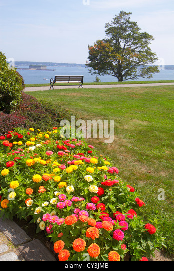 Portland Maine Casco Bay Fort Ft. Allen Park scenic lawn flowers bench tree - Stock Image