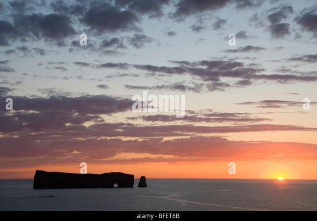 Sunrise at Perce Rock, Bonaventure Island and Perce Rock National Park, Quebec, Canada - Stock Image