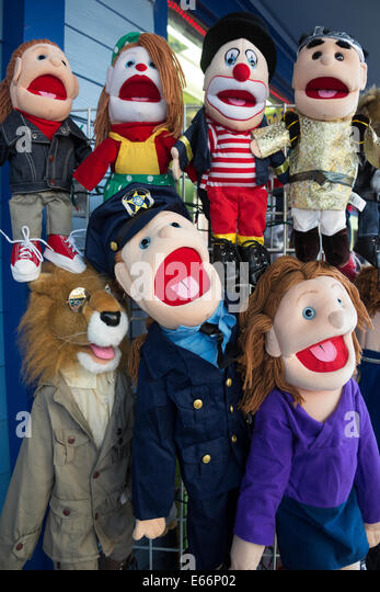Display of funny colourful puppets outside toy shop. - Stock Image