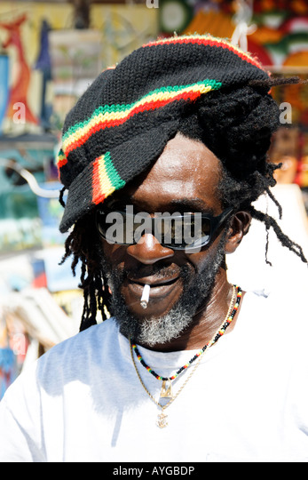 Jamaica Negril beach cool Rastafari man - Stock Image