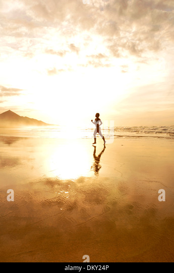 Young woman at the beach, Cofete, Fuerteventura, Canary Islands, Europe - Stock Image
