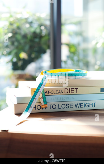 Diet Books And Measuring Tape On Desk - Stock Image