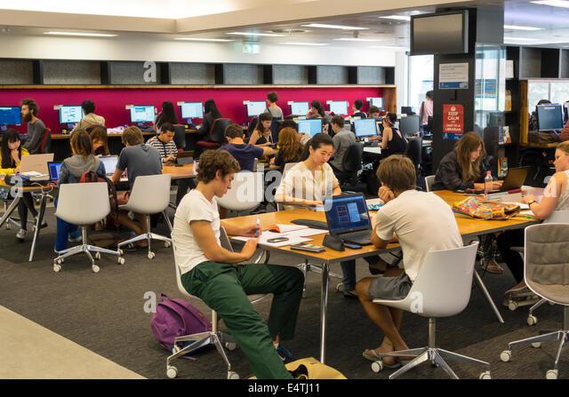 Melbourne Australia Victoria Carlton Parkville University of Melbourne campus school Baillieu Library student man - Stock Image