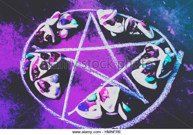 Dark forces still life in a paranormal occult practise of offerings in pizza sacrifice - Stock Image